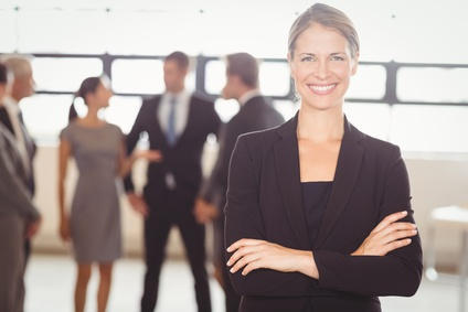 Confident Business Woman with Employee Benefits Team