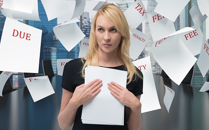Businesswoman overwhelmed by tax regulations on employee benefits programs
