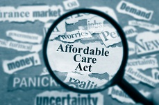 Photo of phrases and magnifying glass that indicate confusion and clarity with the aca individual mandate.